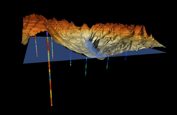 Topographic surface with well sample data and water level. (Image: Golden Software)