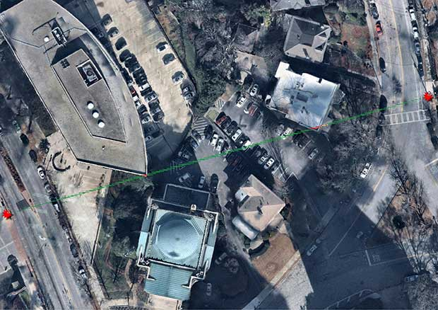 Aerial Imagery reveals signal (green lines) interference (red lines) from buildings — even 30 cm of obstruction can be significant — between microwave towers. (Image: Nearmap)