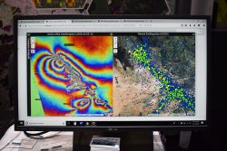 Researchers at the NASA Disasters Program use satellite imagery to create maps to show where damage from a natural disaster has taken place. (Photo: Allison Barwacz)
