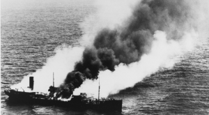 The American tanker SS Harry F. Sinclair burns south of Cape Lookout North Carolina, torpedoed by U-203 on April 11, 1942. (Photo: U.S. Naval History and Heritage Command)